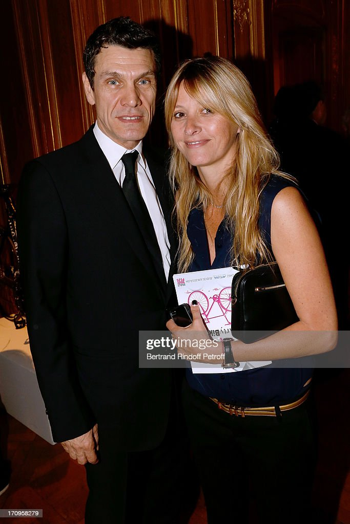 Singer <a gi-track='captionPersonalityLinkClicked' href=/galleries/search?phrase=Marc+Lavoine&family=editorial&specificpeople=545491 ng-click='$event.stopPropagation()'>Marc Lavoine</a> and his wife Sarah Poniatowski attend 'Arty Bike' Auction to benefit Association des Tout P'tits at Artcurial on June 20, 2013 in Paris, France.