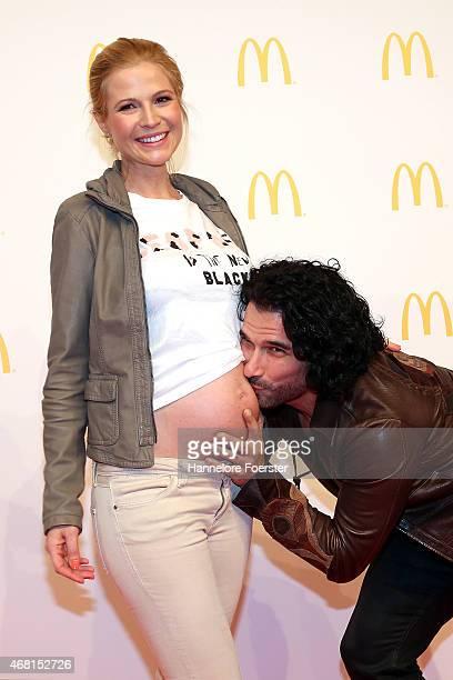 Singer Marc Terenzi and his pregnant girlfriend Myriel Brechtel pose during the new McDonald's Flagship Restaurant reopening at Frankfurt...