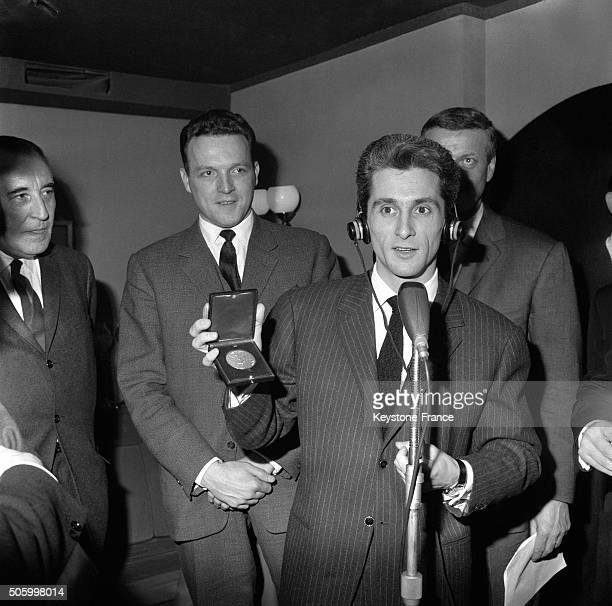 Singer Marcel Amont Receives The Blason D'Or Of The Radiodiffusion Télévision Française in Paris France on January 9 1963