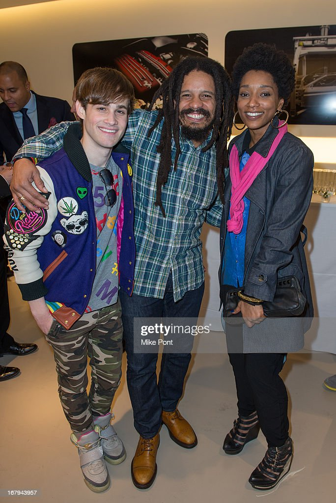 Singer Marco, <a gi-track='captionPersonalityLinkClicked' href=/galleries/search?phrase=Rohan+Marley&family=editorial&specificpeople=1138145 ng-click='$event.stopPropagation()'>Rohan Marley</a> and Singer Res attend Fabrizio Sotti's 'Right Now' Album Listening Party at the Ferrari Corporate Showroom Of New York on May 2, 2013 in New York City.