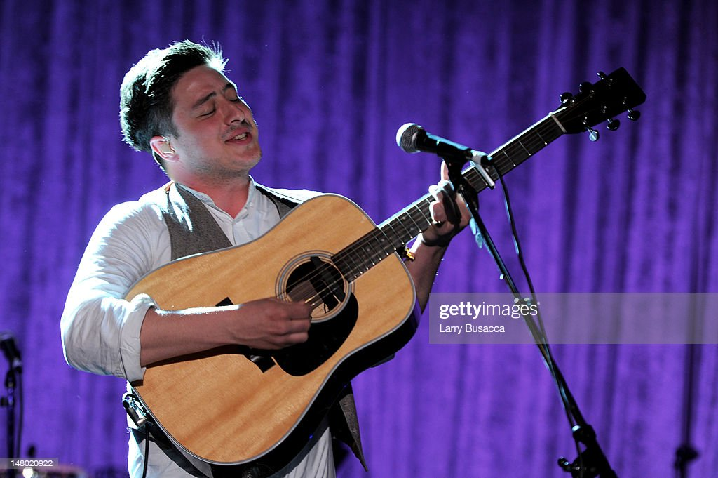 Singer <a gi-track='captionPersonalityLinkClicked' href=/galleries/search?phrase=Marcus+Mumford&family=editorial&specificpeople=5385533 ng-click='$event.stopPropagation()'>Marcus Mumford</a> of the band 'Mumford & Sons' performs at the 2011 Pre-GRAMMY Gala and Salute To Industry Icons Honoring David Geffen at Beverly Hilton on February 12, 2011 in Beverly Hills, California.
