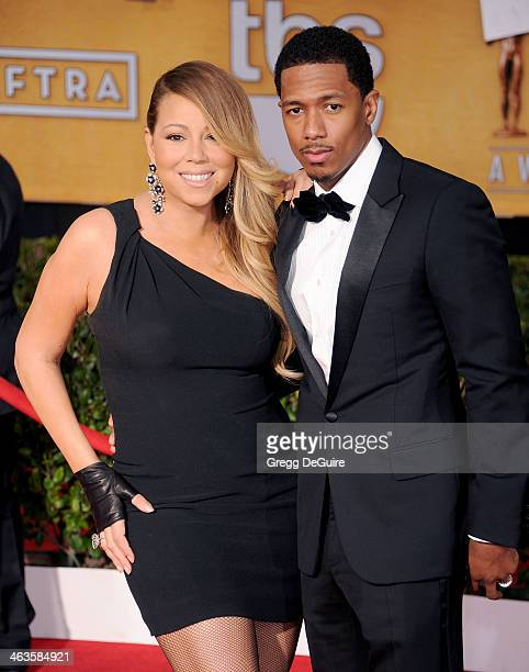 Singer Mariah Carey and actor/TV personality Nick Cannon arrive at the 20th Annual Screen Actors Guild Awards at The Shrine Auditorium on January 18...