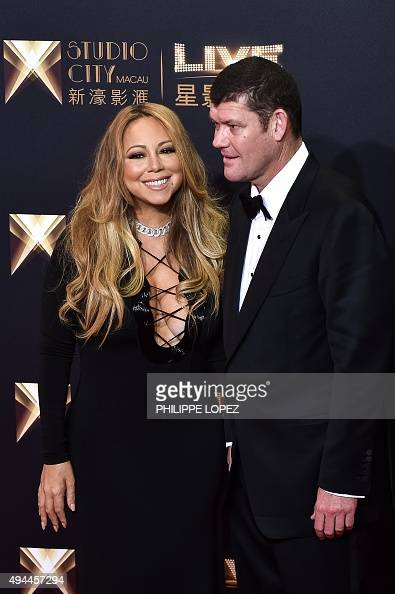 US singer Mariah Carey and cochairman of Melco Crown Entertainment James Packer stand on the red carpet ahead of the opening ceremony of the Studio...