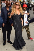 Singer Mariah Carey and Jermaine Dupri enter the 'Late Show With David Letterman' taping at the Ed Sullivan Theater on May 7 2014 in New York City