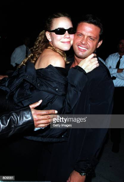 Singer Mariah Carey and Luis Miguel arrive at Mr Chow's restaurant February 18 2001 in Beverly Hills CA