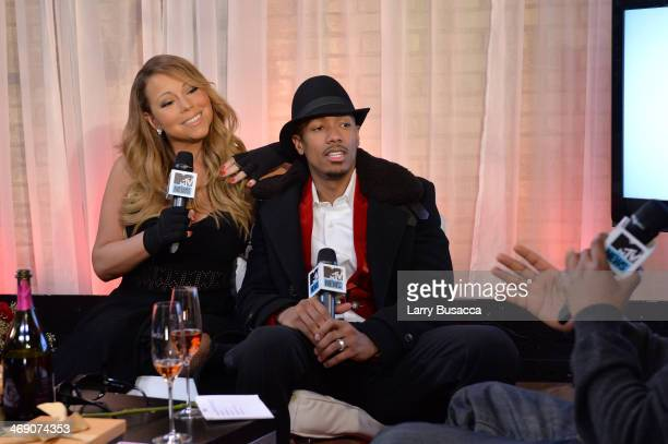 Singer Mariah Carey and Nick Cannon attend MTV First Mariah Carey's 'You're Mine ' music video world premiere at MTV Studios on February 12 2014 in...