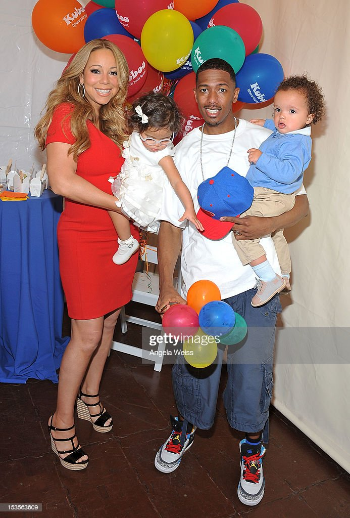 Singer <a gi-track='captionPersonalityLinkClicked' href=/galleries/search?phrase=Mariah+Carey&family=editorial&specificpeople=171647 ng-click='$event.stopPropagation()'>Mariah Carey</a> and TV personality Nick Cannon pose for pictures with their twins <a gi-track='captionPersonalityLinkClicked' href=/galleries/search?phrase=Monroe+Cannon&family=editorial&specificpeople=8561967 ng-click='$event.stopPropagation()'>Monroe Cannon</a> and <a gi-track='captionPersonalityLinkClicked' href=/galleries/search?phrase=Moroccan+Scott+Cannon&family=editorial&specificpeople=8796737 ng-click='$event.stopPropagation()'>Moroccan Scott Cannon</a> during 'Family Day' at Santa Monica Pier on October 6, 2012 in Santa Monica, California.