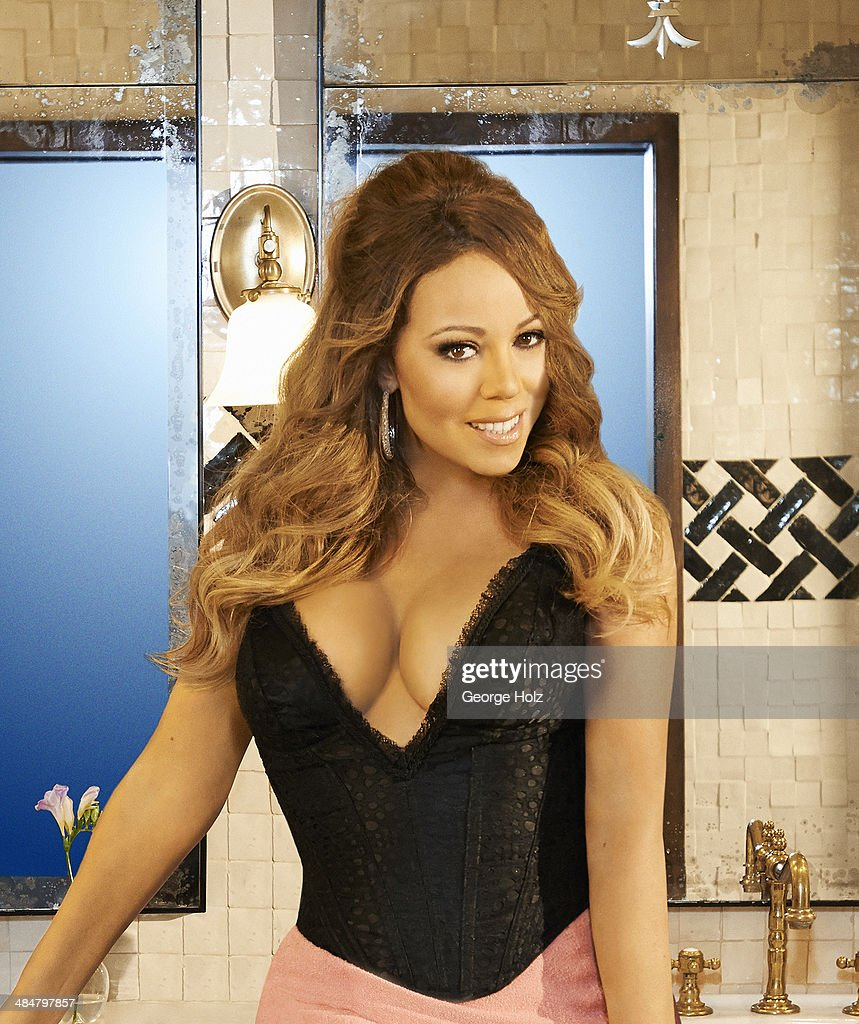Singer <a gi-track='captionPersonalityLinkClicked' href=/galleries/search?phrase=Mariah+Carey&family=editorial&specificpeople=171647 ng-click='$event.stopPropagation()'>Mariah Carey</a> is photographed for Ebony Magazine on November 2, 2013 in New York City.