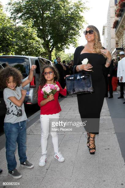 Singer Mariah Carey Monroe Cannon and Moroccan Scott Cannon leave the Plaza Athenee Dorchester Collection Hotel on Avenue Montaigne on June 24 2017...