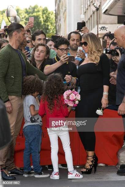 Singer Mariah Carey poses for a selfie as she leaves the Plaza Athenee Dorchester Collection Hotel on Avenue Montaigne on June 24 2017 in Paris France