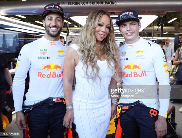 Singer Mariah Carey poses with Red Bull Racing drivers Daniel Ricciardo of Australia and Max Verstappen of the Netherlands prior to the Azerbaijan...