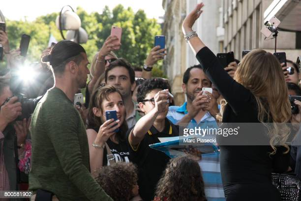 Singer Mariah Carey waves at her french fans as she leaves the Plaza Athenee Dorchester Collection Hotel on Avenue Montaigne on June 24 2017 in Paris...