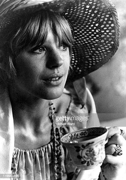 Singer Marianne Faithfull having a cup of tea at home 1967