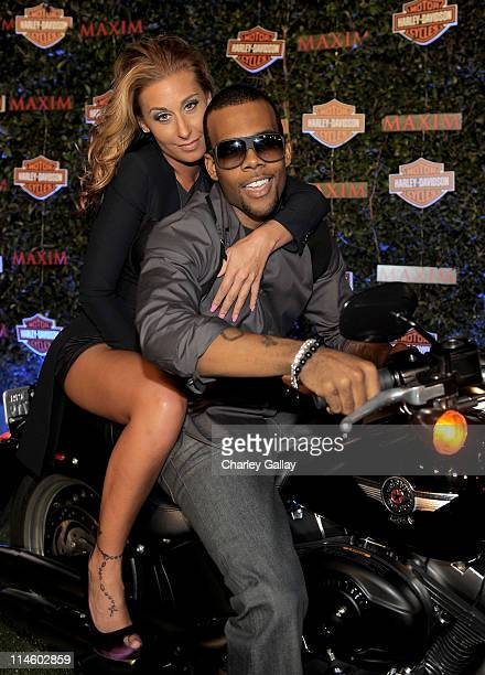 Singer Mario and guest turn the key on a HarleyDavidson to raise money for Harley's Heroes at the 2010 Maxim Hot 100 Party held at Paramount Studios...