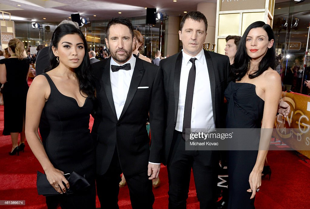 Singer Mariqueen Maandig, musician Trent Reznor, musician Atticus Ross and model Liberty Ross attend the 72nd Annual Golden Globe Awards at The Beverly Hilton Hotel on January 11, 2015 in Beverly Hills, California.