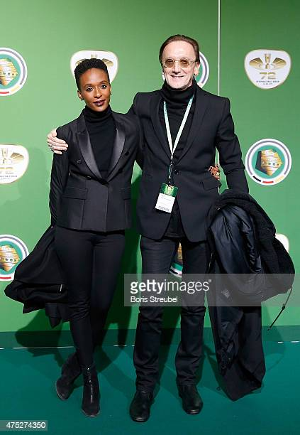 Singer Marius MuellerWesternhagen and his girldfriend Lindiwe Suttle pose for a photo at the green carpet prior to the DFB Cup Final between Borussia...