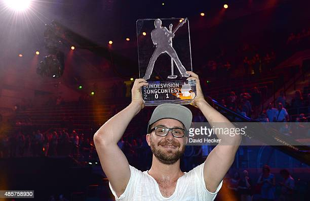 Singer Mark Forster celebrates after winning the Bundesvision Song Contest 2015 at OVBArena on August 29 2015 in Bremen Germany On the left...