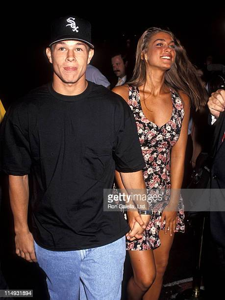 Singer Mark Wahlberg and date attend the 'Death Becomes Her' Premiere Party on July 13 1992 at Planet Hollywood in New York City