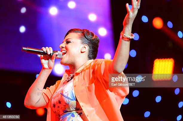 Singer Marsha Ambrosius performs onstage at the Maxwell Jill Scott Marsha Ambrosius and Candice Glover concert during the 2014 BET Experience At LA...