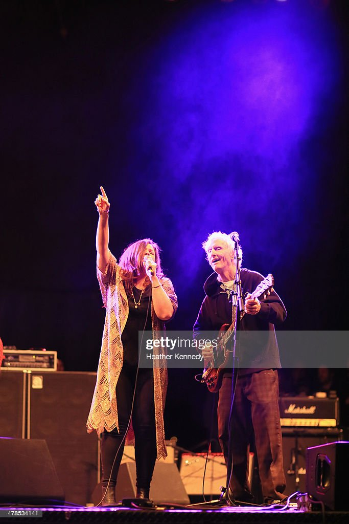 Singer Mary Bridget Davies and musician Robby Krieger perform onstage at the USPS Hendrix Stamp Event + Los Lonely Boys during the 2014 SXSW Music, Film + Interactive at Butler Park on March 13, 2014 in Austin, Texas.