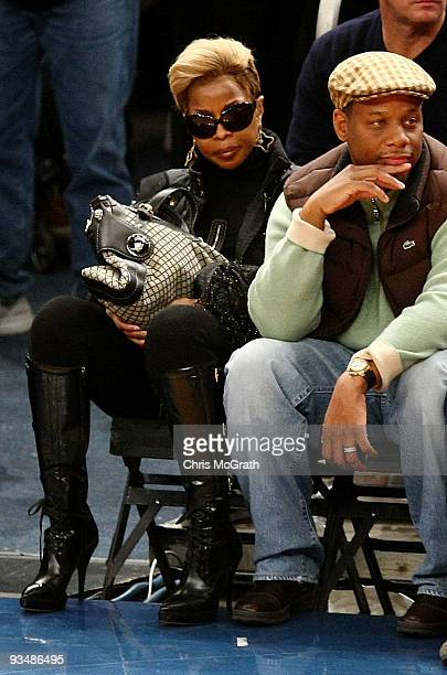 Singer Mary J Blige and Kendu Isaacs watches on during the game between the Orlando Magic and the New York Knicks at Madison Square Garden November...
