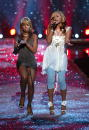 Singer Mary J Blige and rapper Eve perform onstage at the Victoria's Secret Fashion Show at the 69th Regiment Armory November 13 2003 in New York...