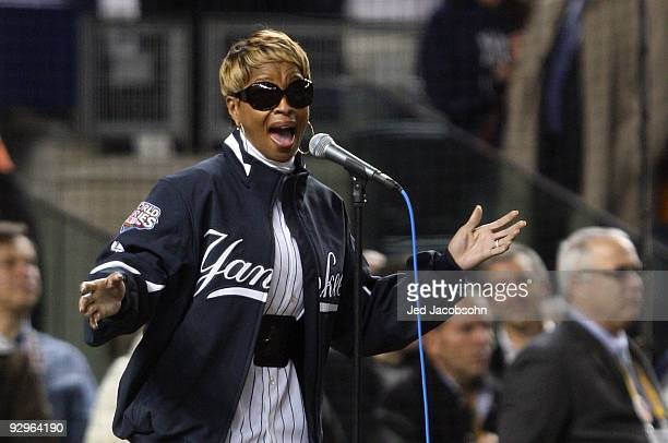 Singer Mary J Blige performs the National Anthem prior to Game Six of the 2009 MLB World Series between the New York Yankees and the Philadelphia...