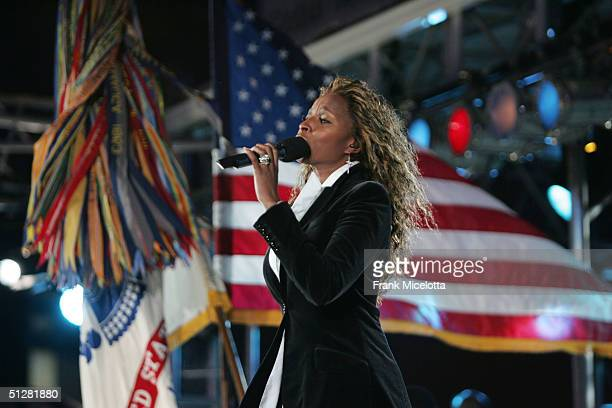 Singer Mary J Blige sings the national anthem with the Boston Pops Orchestra before the NFL opening game between the Indianapolis Colts vs the New...