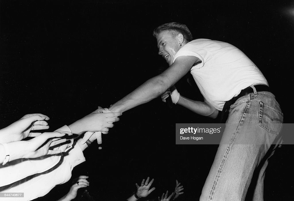 Singer Matt Goss with the band 'Bros' being grabbed by fans as he performs on stage 1988