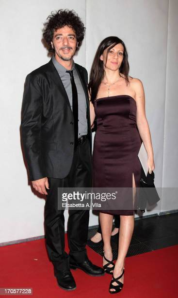 Singer Max Gazze and fiancee attend 2013 Premi David di Donatello Ceremony Awards at Dear RAI Studios on June 14 2013 in Rome Italy