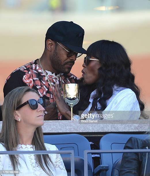 Singer Maxwell and Naomi Campbell attend The Moet Chandon Suite at the USTA Billie Jean King National Tennis Center on September 6 2013 in New York...