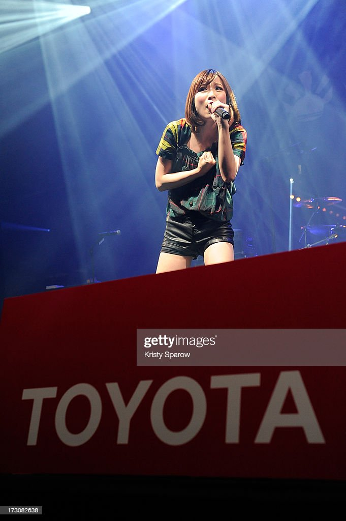 Singer May'n performs during the JE live house 'TOYOTA x STUDIO4AC meets ANA PES' concert during the Japan Expo at Paris-nord Villepinte Exhibition Center on July 6, 2013 in Paris, France.