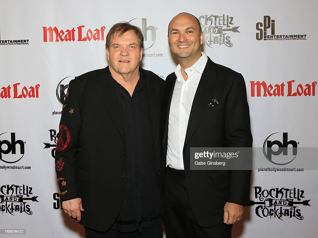 Singer Meat Loaf (L) and Founder and CEO of SPI Entertainment Adam Steck arrive at the show 'RockTellz & CockTails presents Meat Loaf' at Planet Hollywood Resort & Casino on October 3, 2013 in Las Vegas, Nevada.