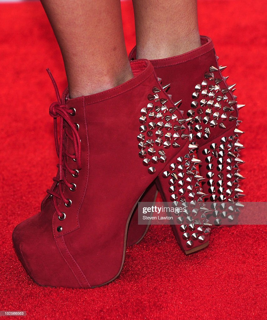 Singer Megan Mace (shoes detail) of Megan and Lace pose in the press room at the iHeartRadio Music Festival at the MGM Grand Garden Arena September 21, 2012 in Las Vegas, Nevada.