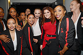 Singer Meghan Trainor poses with her backup dancers backstage at the iHeartRadio Music Awards which broadcasted live on TBS TNT AND TRUTV from The...