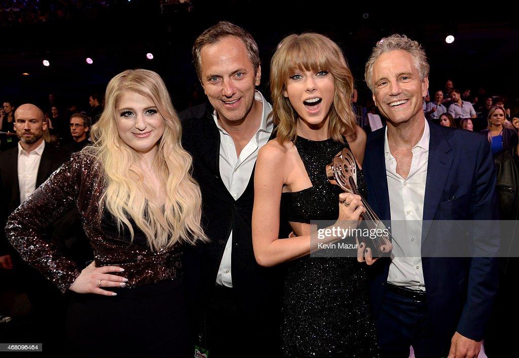 Singer Meghan Trainor President of National Programming Platforms for iHeartMedia Tom Poleman singer Taylor Swift and President of Entertainment...