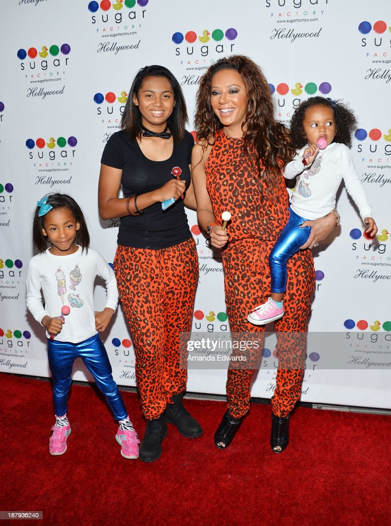 Singer Mel B and her daughters (L-R) <a gi-track='captionPersonalityLinkClicked' href=/galleries/search?phrase=Angel+Iris+Murphy&family=editorial&specificpeople=6833438 ng-click='$event.stopPropagation()'>Angel Iris Murphy</a> Brown, <a gi-track='captionPersonalityLinkClicked' href=/galleries/search?phrase=Phoenix+Chi+Gulzar&family=editorial&specificpeople=3339647 ng-click='$event.stopPropagation()'>Phoenix Chi Gulzar</a> and Madison Brown Belafonte arrive at the grand opening of Sugar Factory Hollywood at Sugar Factory on November 13, 2013 in Hollywood, California.
