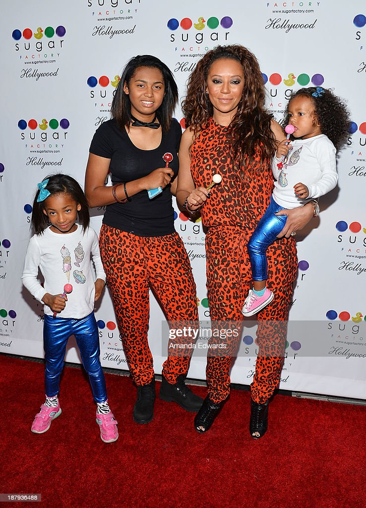 Singer Mel B and her daughters (L-R) Angel Iris Murphy Brown, Phoenix Chi Gulzar and Madison Brown Belafonte arrive at the grand opening of Sugar Factory Hollywood at Sugar Factory on November 13, 2013 in Hollywood, California.