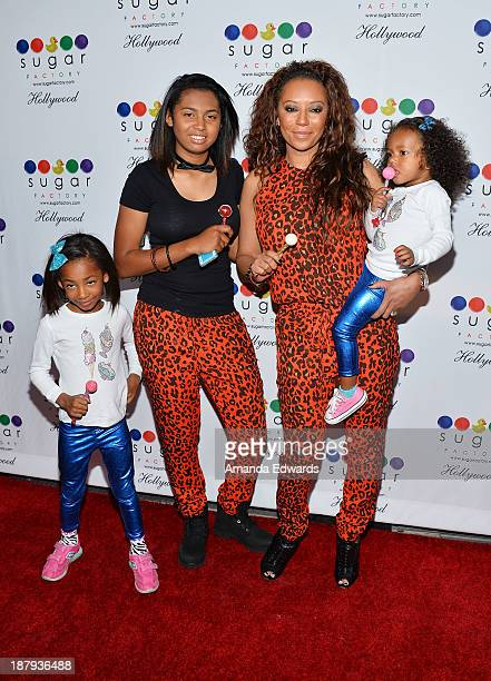 Singer Mel B and her daughters Angel Iris Murphy Brown Phoenix Chi Gulzar and Madison Brown Belafonte arrive at the grand opening of Sugar Factory...