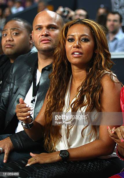 Singer Mel B and her husband Stephen Belafonte look on during the round five NBL match between the Sydney Kings and the Melbourne Tigers at the...