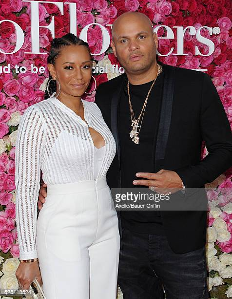 Singer Mel B and producer Stephen Belafonte arrive at the Open Roads World Premiere Of 'Mother's Day' at TCL Chinese Theatre IMAX on April 13 2016 in...