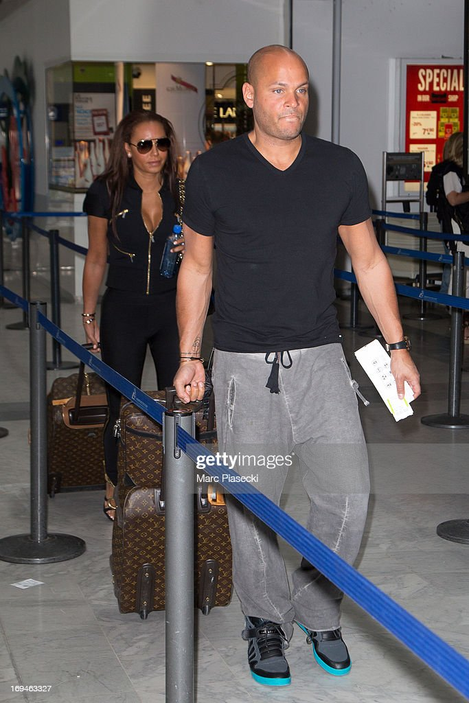 Singer Mel B and <a gi-track='captionPersonalityLinkClicked' href=/galleries/search?phrase=Stephen+Belafonte&family=editorial&specificpeople=4361206 ng-click='$event.stopPropagation()'>Stephen Belafonte</a> are sighted at Nice airport during the 66th Annual Cannes Film Festival on May 25, 2013 in Nice, France.
