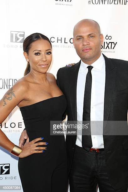 Singer Mel B and Stephen Belafonte attend the Los Angeles Confidential celebration of the Women of Influence issue with Robin Wright on June 4 2014...