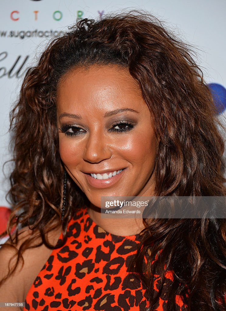 Singer Mel B arrives at the grand opening of Sugar Factory Hollywood at Sugar Factory on November 13, 2013 in Hollywood, California.