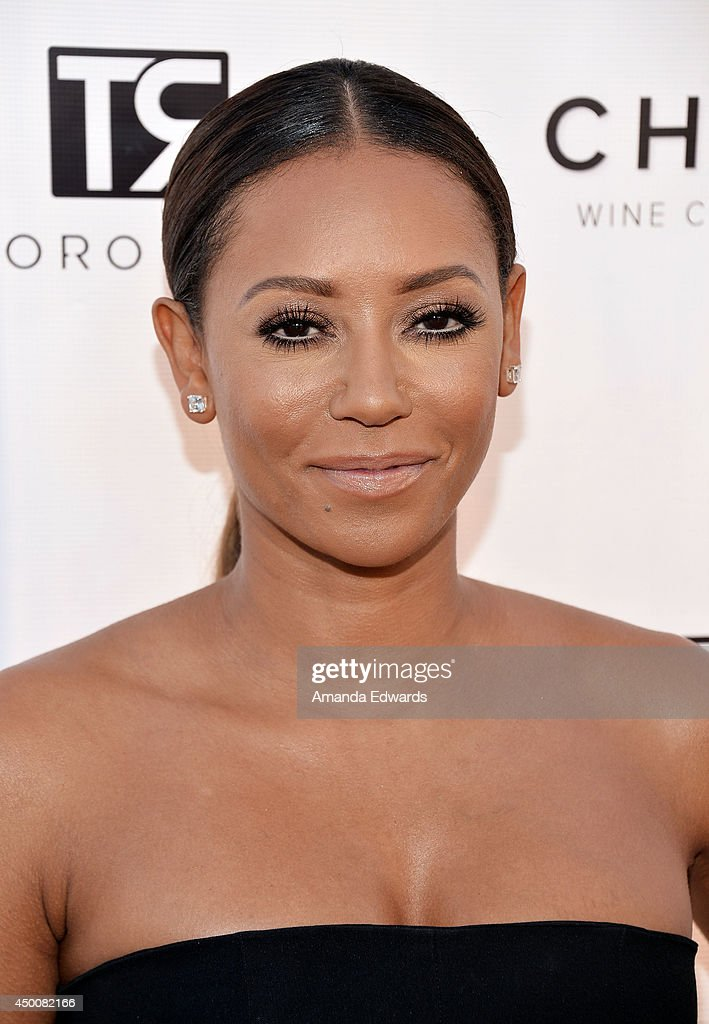 Singer Mel B arrives at the Los Angeles Confidential Magazine and cover star Robin Wright celebration of the magazine's Women Of Influence issue at SIXTY Beverly Hills on June 4, 2014 in Beverly Hills, California.