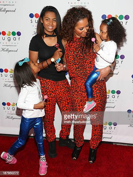 Singer Melanie Brown and her daughters Angel Iris Murphy Brown Phoenix Chi Gulzar and Madison Brown Belafonte attend the Sugar Factory Hollywood...