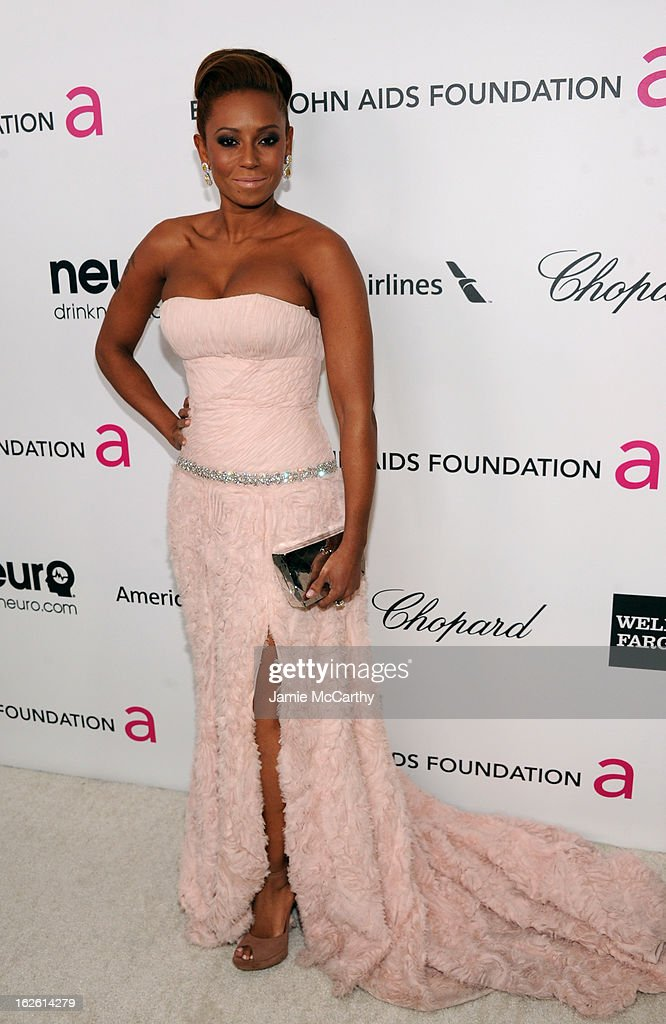 Singer Melanie Brown attends the 21st Annual Elton John AIDS Foundation Academy Awards Viewing Party at West Hollywood Park on February 24, 2013 in West Hollywood, California.
