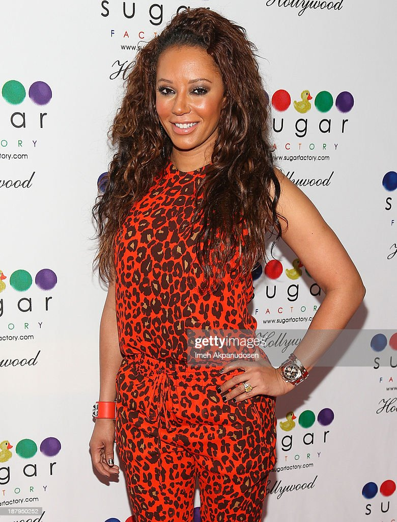 Singer <a gi-track='captionPersonalityLinkClicked' href=/galleries/search?phrase=Melanie+Brown&family=editorial&specificpeople=159736 ng-click='$event.stopPropagation()'>Melanie Brown</a> attends the Sugar Factory Hollywood grand opening at Sugar Factory on November 13, 2013 in Hollywood, California.