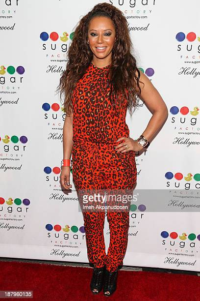 Singer Melanie Brown attends the Sugar Factory Hollywood grand opening at Sugar Factory on November 13 2013 in Hollywood California