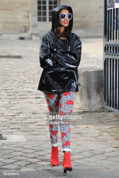 Singer MIA leaves the Balenciaga Fashion Show during Paris Fashion Week Womenswear SS14 Day 3 on September 26 2013 in Paris France